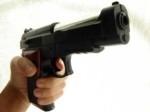 omicida con pistola