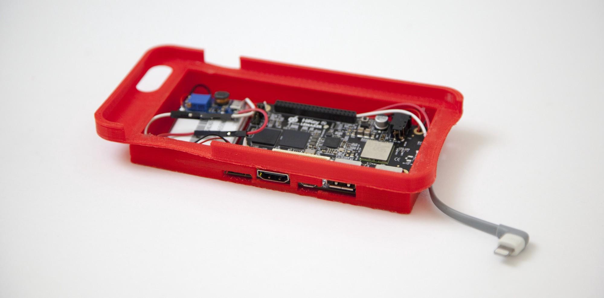 Figura 3: Custodia per la scheda Hikey e la batteria con il circuito di regolazione e protezione