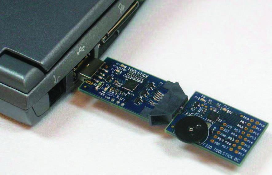 Figura 2: ToolStick per C8051F330 con adattatore collegato ad un pc.