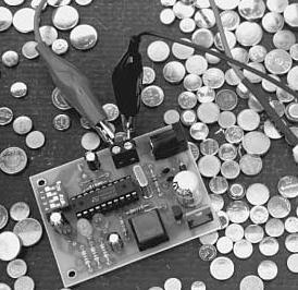 Rigeneratore per batterie a bottone